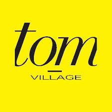tom village